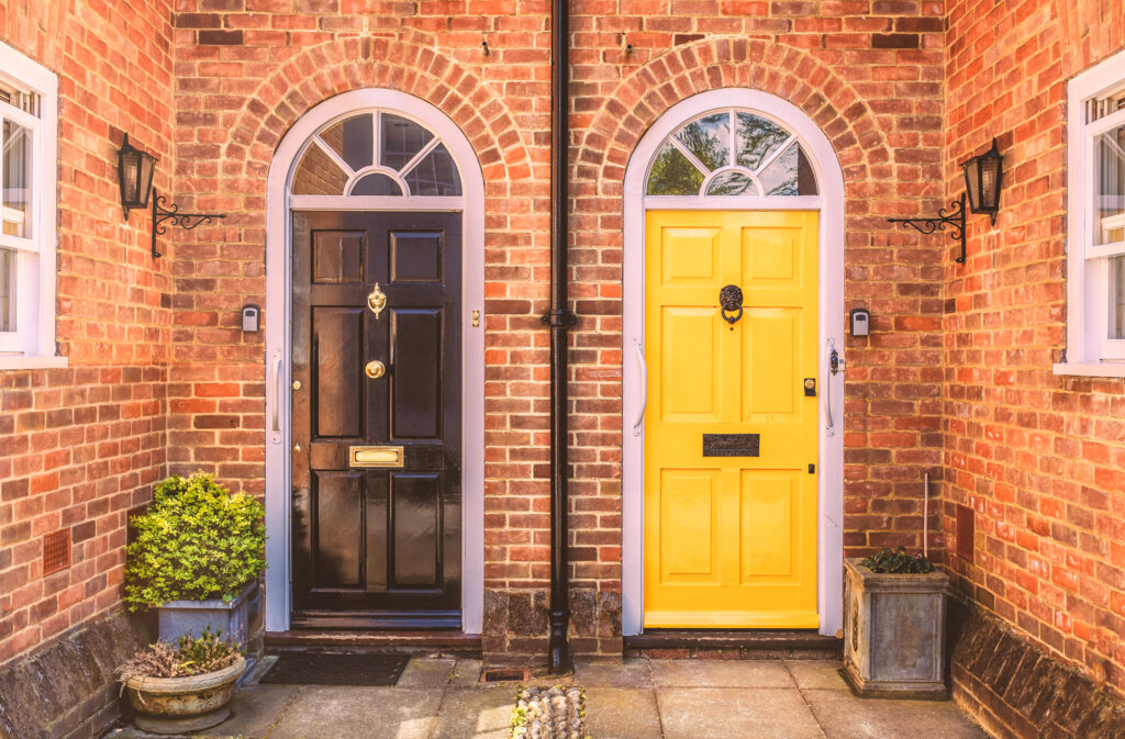 Two residential front doors, one black one yellow