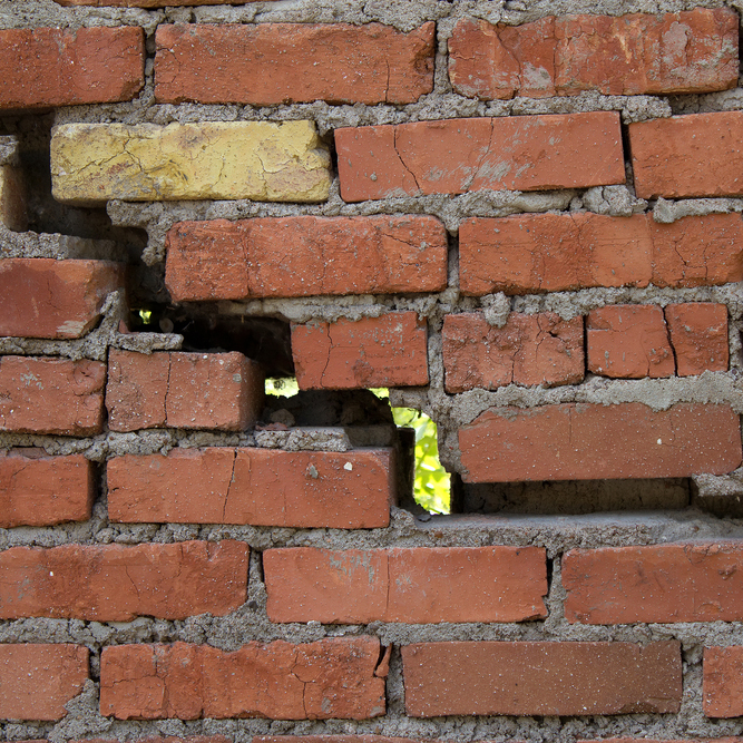 cracking brick wall