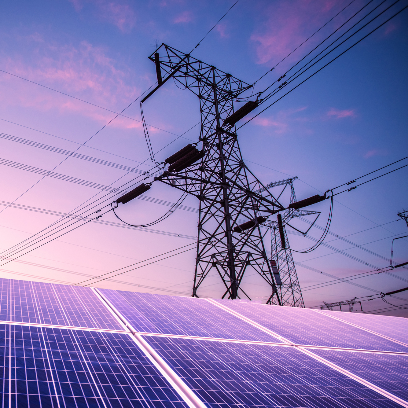 solar panels and electricity pylons